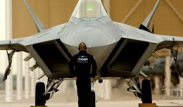 "DAVIS-MONTHAN AIR FORCE BASE, Ariz. -- A crew chief for the F-22 Deomonstration Team prepares Major David ""Zeke"" Skalicky  for takeoff during the Heritage Flight Conference March 6. The Raptor is the world's only operational fifth generation fighter aircraft."